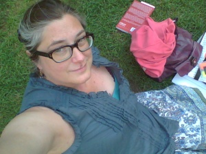 This is me, hanging out in Bryant Park, trying to focus on actual academic reading for a change