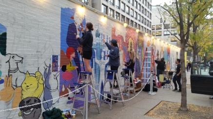 FIT Illustration students, painting the wall on 28th street